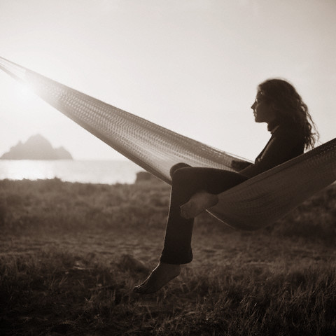 California, USA --- Woman Sitting in Hammock --- Image by © Caterina Bernardi/zefa/Corbis